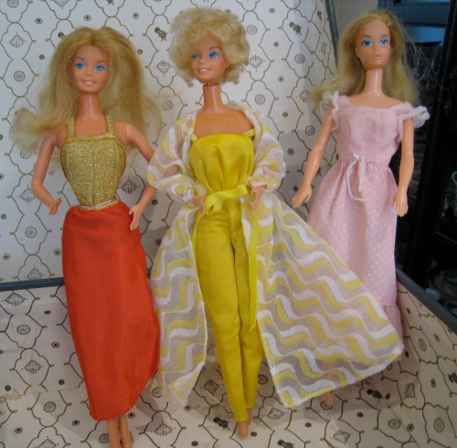 In their original outfits: Free Moving Barbie, 1976; Fashion Photo Barbie; Sweet 16 Barbie, 1974